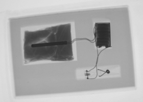 Screenshot of Mailroom X-ray inspection system on Windows Embedded operating system.  The X-ray images shows a parcel containing a suspect device.  The components are highlighted using image processing techniques more commonly associated with non-destructive test (NDT) applications.